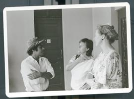 Susan Johnson in discussion with unknown individuals